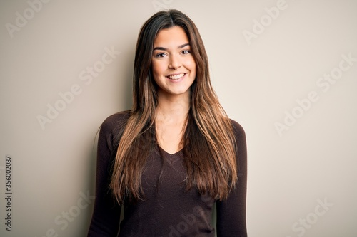 Fototapeta Young beautiful girl wearing casual sweater standing over isolated white background with a happy and cool smile on face. Lucky person. obraz