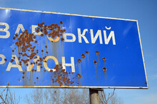 Bullet Holes In A Traffic Sign...