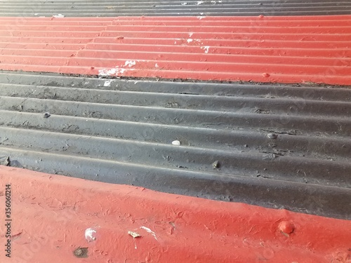 red and black painted sheet metal or background