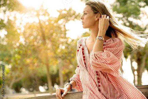 Fotografiet Beautiful bohemian woman bathing in sunlight surrounded by nature