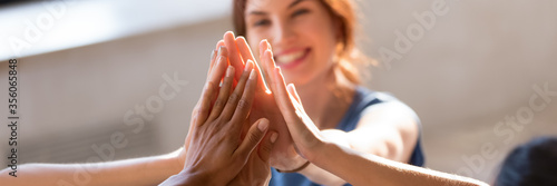 Photo Horizontal photo banner for website header design, group of diverse young people giving high five feels excited close up focus on stacked palms