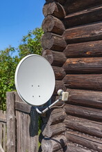 Satellite TV Dish On The Log W...
