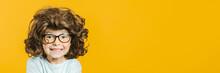Model Child Posing On Yellow B...