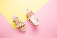 Female Summer Sandals On A Yel...