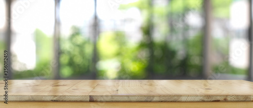 Fototapeta Empty wooden counter bar, wooden table with blurred backyard background obraz