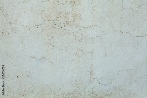 Fototapeta Light blue weathered wall texture. Old Background with crack obraz
