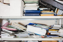 Declutter Concept - Lots Of Books, Papers, Boxes On Shelf - Chaos, Clutter, Mess, Unorganized