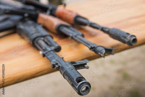Photo assault rifle AK-47 on a wooden surface
