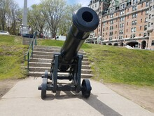 Old Black Cannon On Wheels In Quebec, Canada