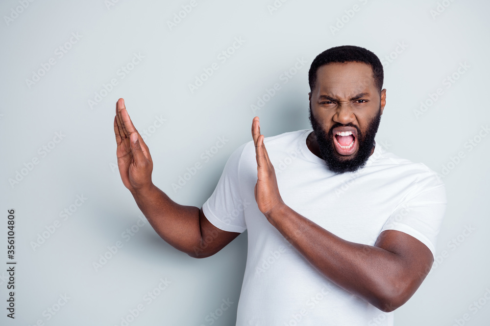 Fototapeta Photo of crazy yelling mad dark skin african americn guy antiracism group leader say no violence behavior to black people lawlessness raise arms empty space isolated grey color background