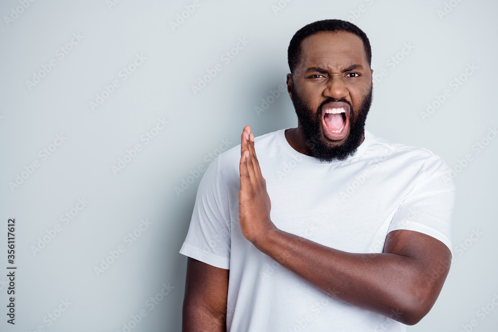 Fototapeta Photo of crazy disappointed yell dark skin african guy antiracism group member leader say no violence behavior black lawlessness raise arm empty space unfair isolated grey color background