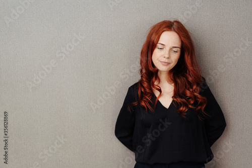 Sad thoughtful woman with downcast expression Wallpaper Mural