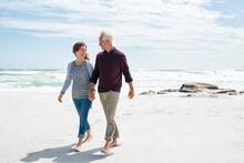 Middle Aged Couple Enjoying Beach