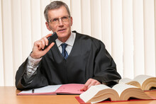 Judge Or Lawyer Dictating A Ju...