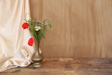 Wildflowers, Red Poppies In An Old Brass Jug On An Old Wooden Table, White Silk Drapery, The Concept Of The Dutch Still Life