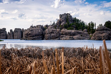 Marshes, Reeds And Boulders Li...