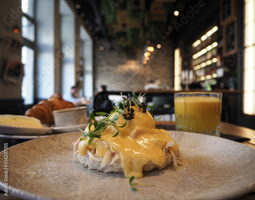 Fototapeta restaurant table with breakfast obraz