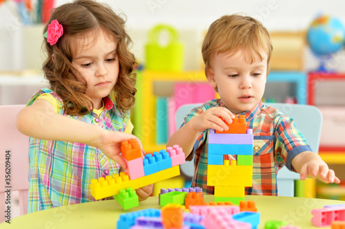 Portrait of bother and sister playing with cubes Canvas Print