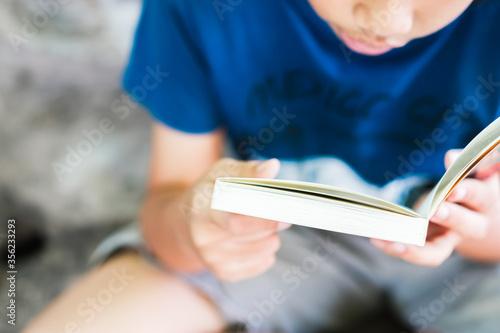 Obraz na plátně Closeup Child Reading Book