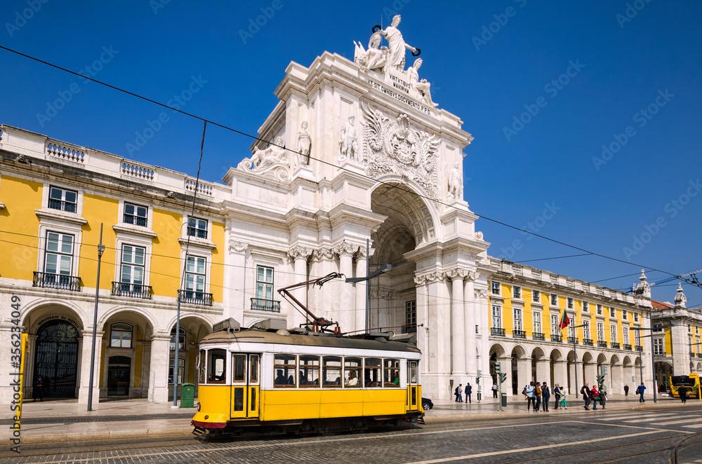 Fototapeta Historic yellow tram in Lisbon, Portugal