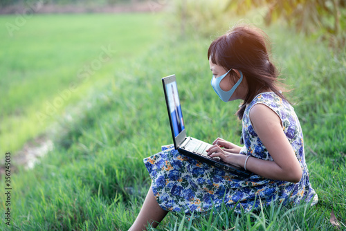 Fotografie, Tablou Happy little child girl learning outdoor by studying online and working on lapto