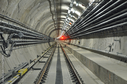 Metro tunnel (subway or underground) with precast concrete linings (segments or rings) with a red light (red signal)