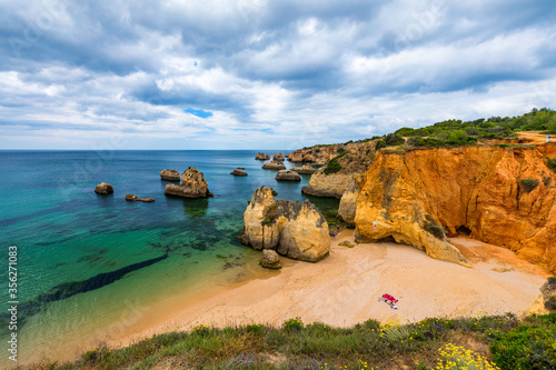 Fotografie, Obraz View of stunning beach with golden color rocks in Alvor town , Algarve, Portugal