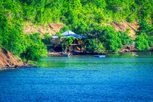 House Near Ocean In The Tropic...