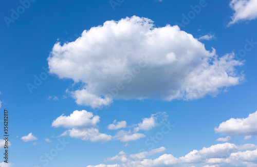 Fotomural Blue sky background with white clouds.