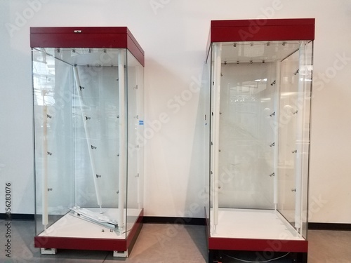 empty red and glass display cases Canvas Print