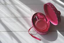 Pink Perfume Bottle On White W...