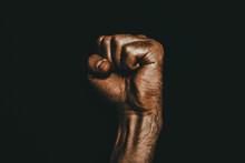 Male Black Fist On A Black Bac...