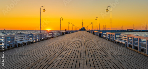 Fototapety, obrazy: Beautiful sunrise over a wooden pier on the Baltic Sea. Sopot, Poland.