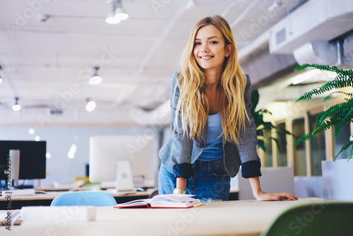 Obraz na plátně Half length portrait of attractive young professional working teacher in university interior