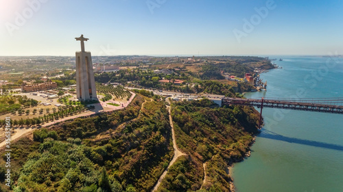 Obraz Aerial bridge on April 25th, across the Tejo River, statue of Jesus Christ Lisbon, Portugal. The longest bridge in Europe. Close-up. - fototapety do salonu