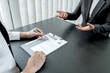 Business people hold a job profile and talk to job applicants for job interviews about careers and business concepts