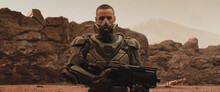 Caucasian Male Star Trooper Posing With A Gun On A Hostile Planet, Space Colonization Concept