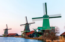 Traditional Dutch Windmills And Handicraft Workshops In The Historical Park Open-air Museum Zaanse Schans In The Spring Sunset. Netherlands, North Holland, Zaandam