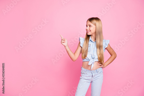 Obraz Portrait of positive confident kid girl promoter point index finger copyspace demonstrate advert promotion wear stylish trendy clothes isolated over pastel color background - fototapety do salonu