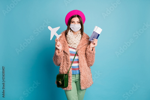 Fotografering Portrait of her she nice healthy girl wearing gauze mask holding in hands docume