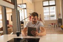 Caucasian Man Using Digital Ta...