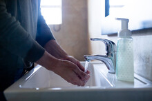 Woman Washing Her Hands Agains...