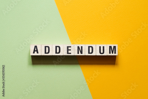 Photo Addendum word concept on cubes