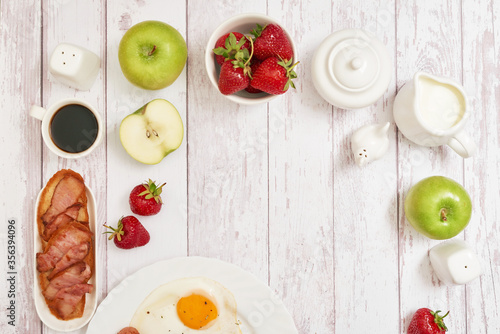 Healthly food. Continental breakfast in hotel room or bed. Fried eggs with sausages. Cup of coffee. Menu template. Cookery. Cooking. Romantic french or rural breakfast on Valentine.