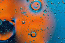 Abstract Colorful Background With Oil Drops And Waves On Water Surface