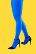canvas print picture Close-up picture of woman's beautiful blue legs in high heels shoes on acid yellow color background. Disco lights. Fasion. Surreal art. Funny modern art collage. Pop art. Zine culture. Side view.