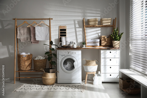 Stylish bathroom interior with modern washing machine Fototapet