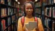 University Library Study: Portrait of a Smart Beautiful Black Girl Holding Study Text Books Smiling Looking at the Camera. Authentic Student Does Research for Class Assignment, Exams Preparationtion