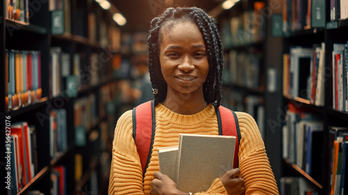 University Library Study: Portrait of a Smart Beautiful Black Girl Holding Study Text Books Smiling Looking at the Camera Canvas Print