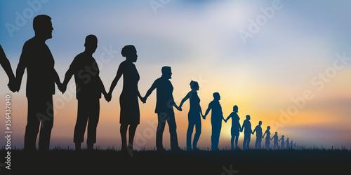 Fotomural Concept de la chaîne humaine et de la solidarité avec un groupe de personnes alignées qui se donnent la main pour montrer que l'union fait la force